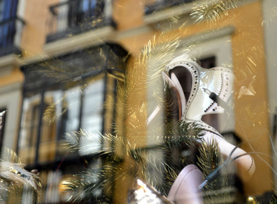 I love, love, love how this turned out. This store window had a Christmas tree with shoes for ornaments (a tree after my own heart). But when combined with the reflection of the building across the street, it's really something wonderful.